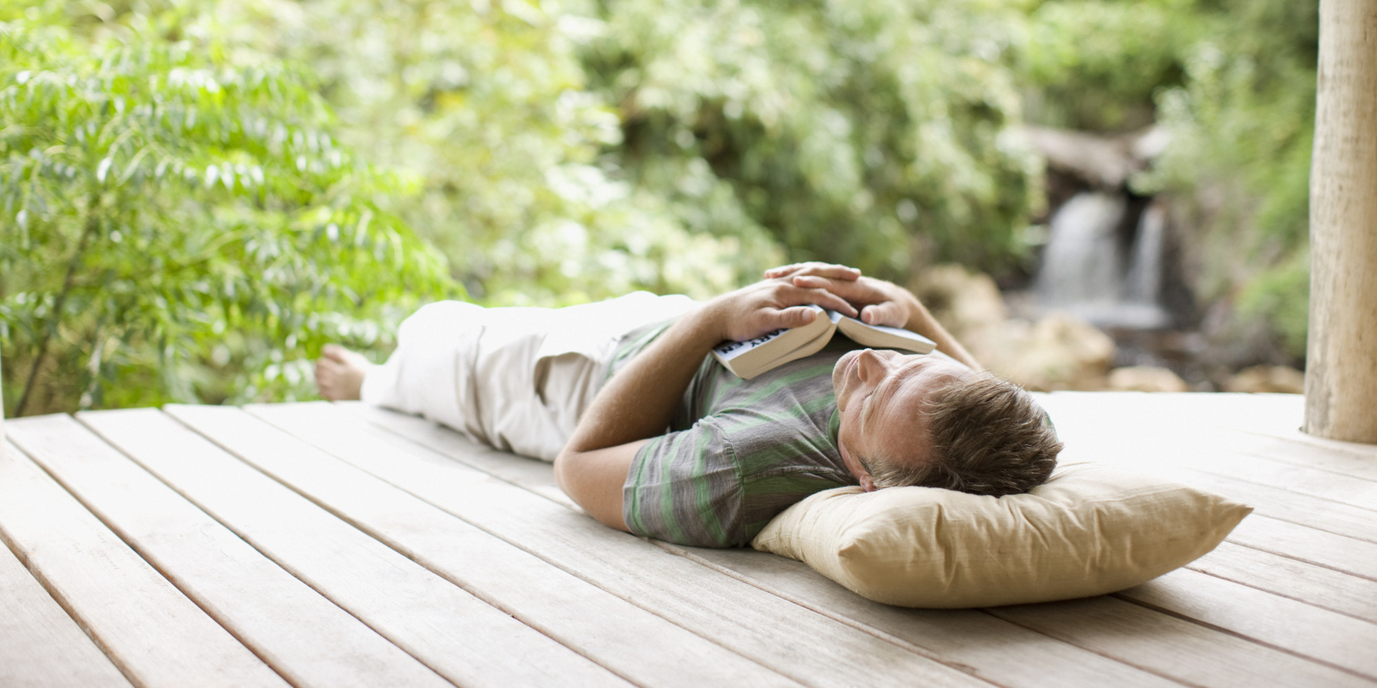 Man napping on porch in remote area