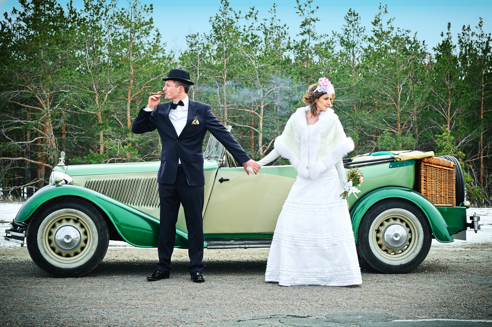 the newly married couple drive retro wedding car